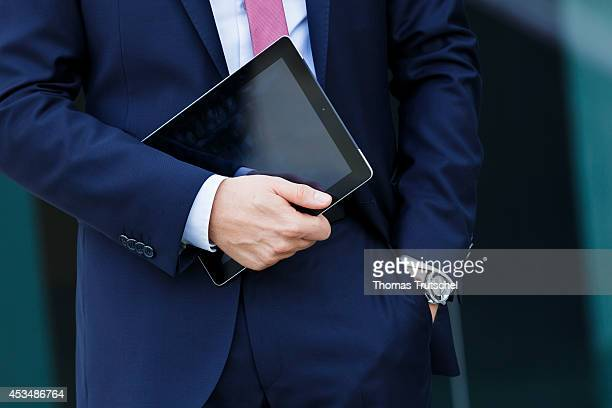 A man in suit holding his iPad on August 07 2014 in Berlin Germany