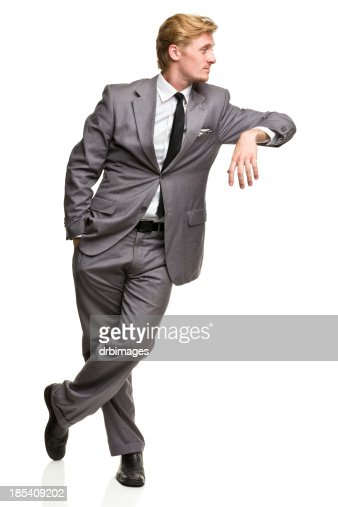 Man in Suit Leans Against Nothing