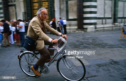 Man in suit on bike. : Stock Photo