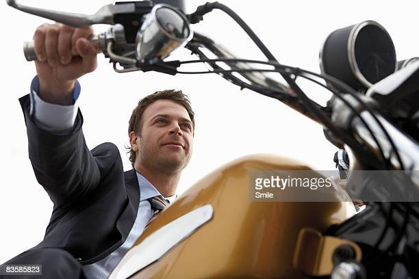 man in suit riding motorcycle