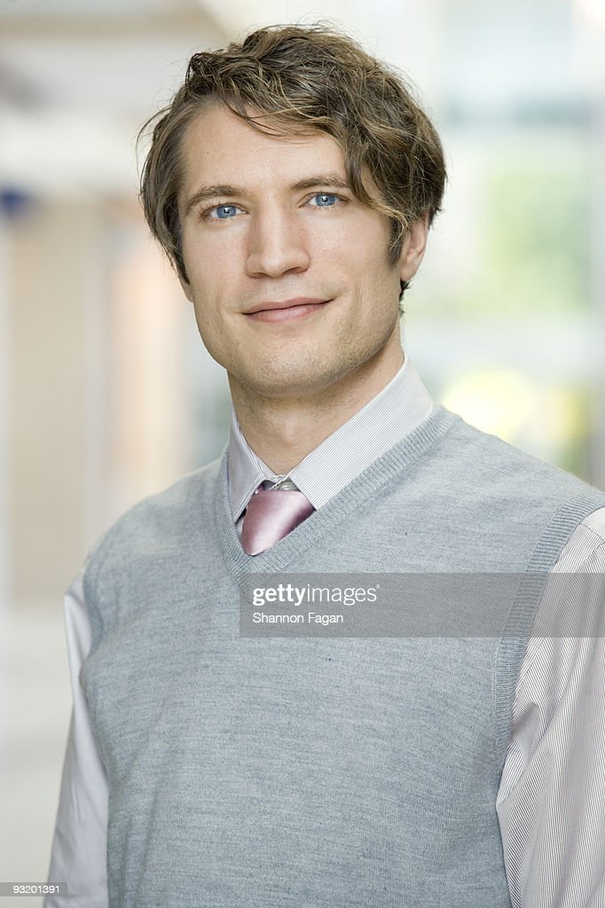 Man in suit smiling : Stock Photo