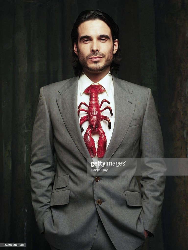 Man in suit wearing lobster in place of tie : Stock Photo