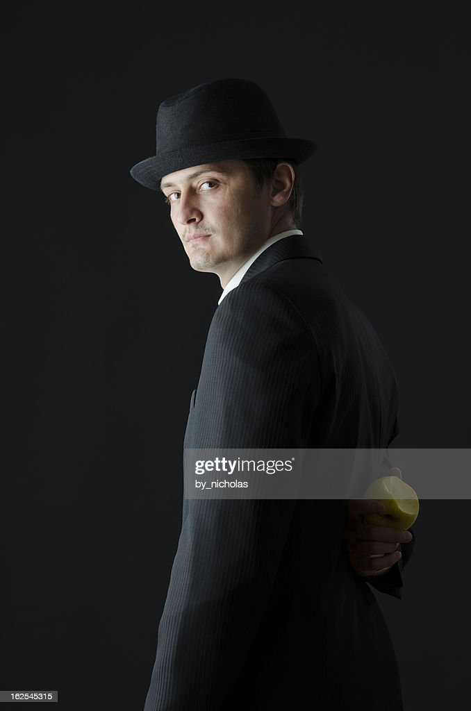 Man in suit with hat, looking at the camera