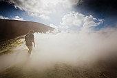 Man in sulphurous steam on a vulcano