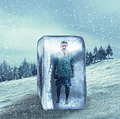Man in summer clothes frozen in an ice cube