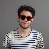 Man in sunglasses, smiling to camera