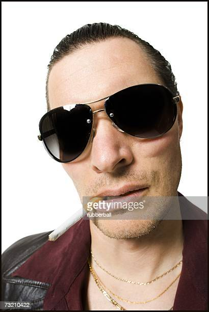 Man in sunglasses smoking cigarette
