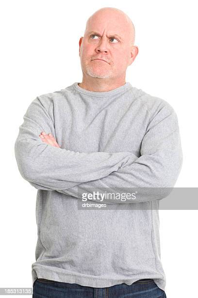Man in sweater thinking and looking up on white background