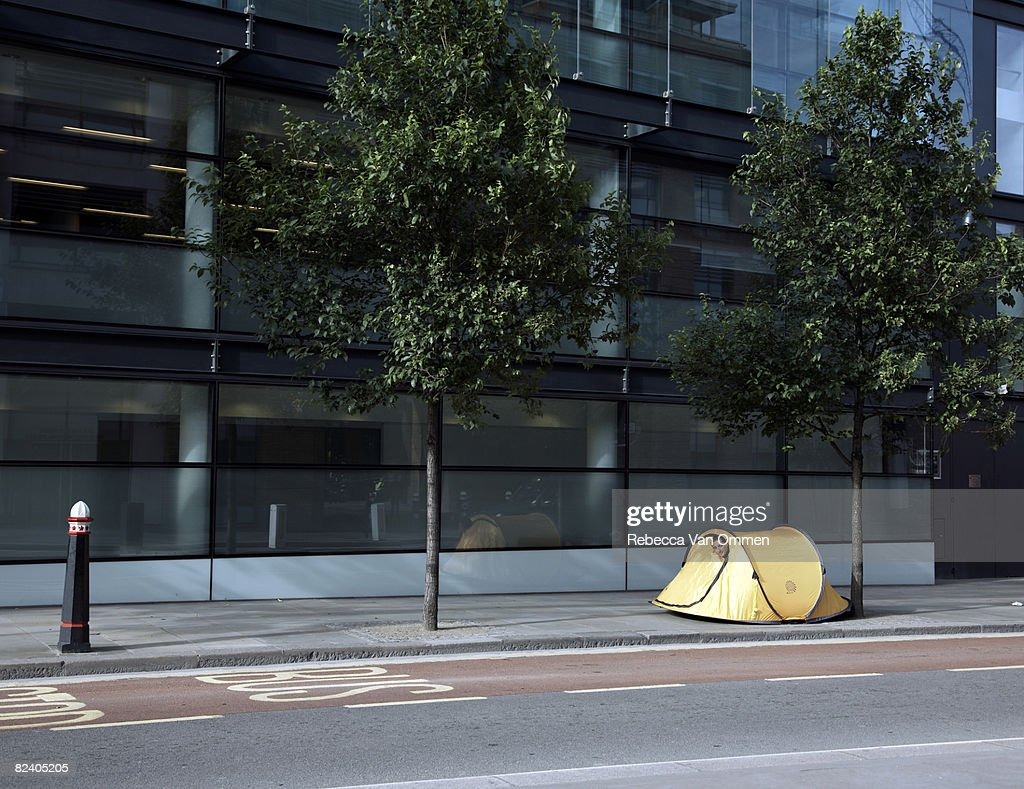 Man in tent on street : Stock Photo