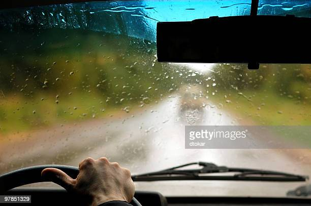 Man in the car when rain is going