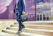 Image of businessman leaving office building