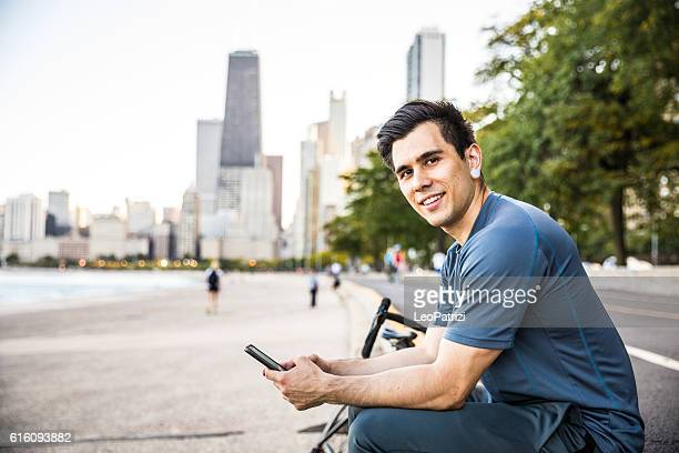 Man in the city street texting on the smartphone