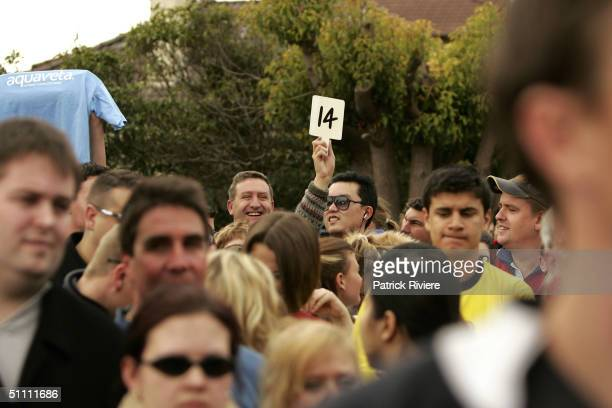 A man in the crowd makes an offer during the auction of the first two units of the second series of the reality television show 'The Block' July 24...
