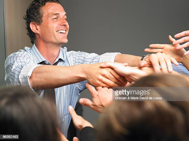 Man in the crowd, shaking people's hands