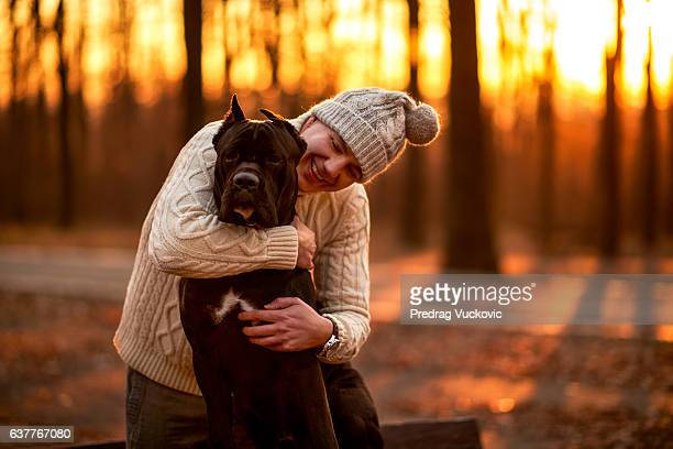 Man in the park with Cane Corso
