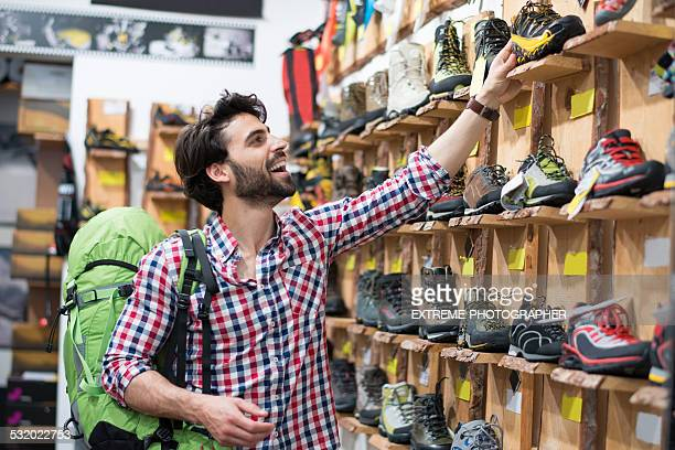 Man in the store buying hiking shoes