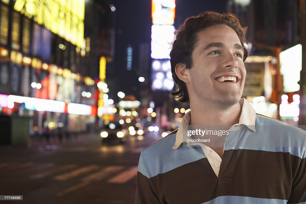 Man in Times Square at Night : Stock Photo