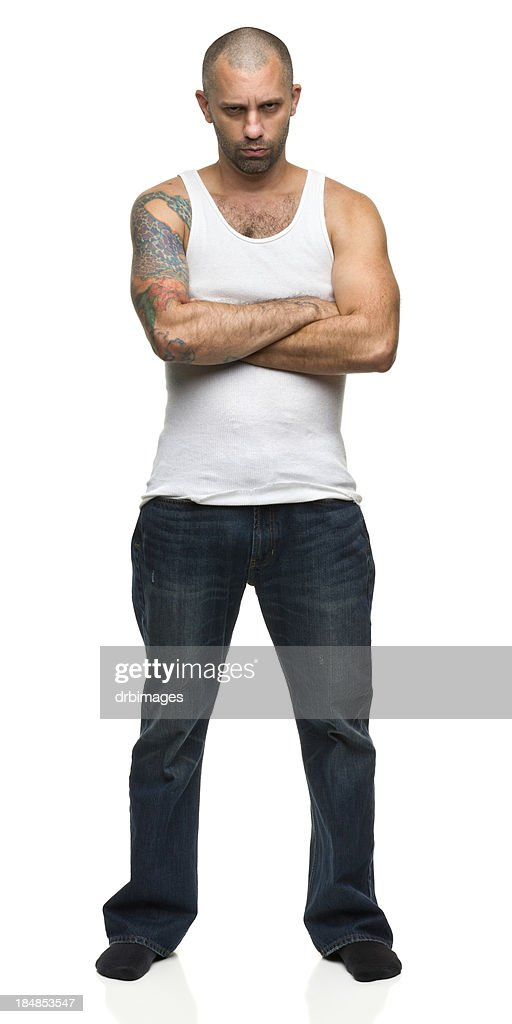 Man in Tough Guy Pose With Arms Crossed