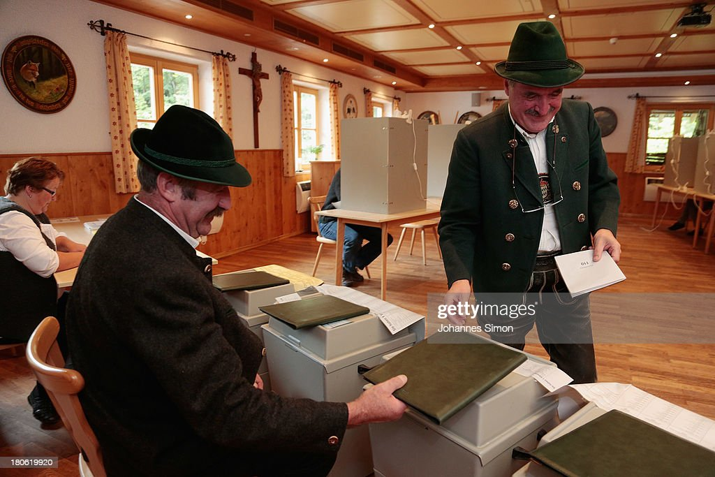 A man in traditional Bavarian clothes casts his vote for the Bavarian elections on September 15, 2013 in Jachenau, Germany. The outcome in Bavaria will be seen by many as an important indicator ahead of German federal elections scheduled for September 22.