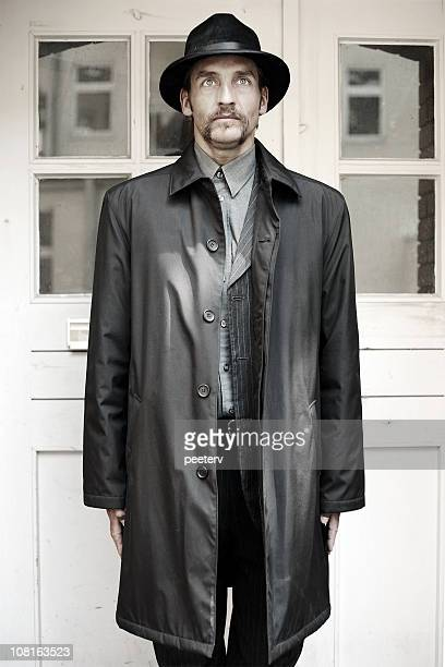 Man in Trench Coat and Hat