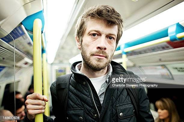 Man in tube carriage.
