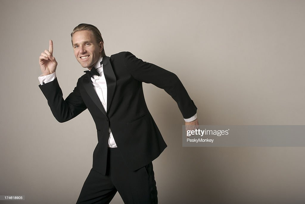 Man in Tuxedo Dances for the Camera