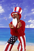 Man in Uncle Sam costume holding sparklers