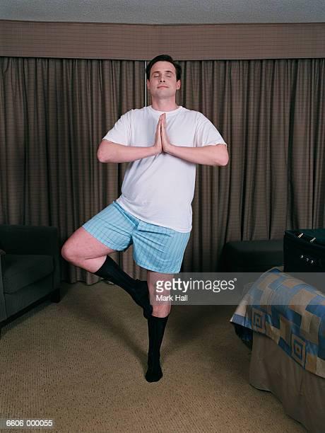 Man in Underwear Doing Yoga
