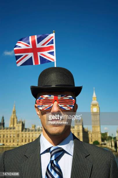 Man in Union Jack Bowler Hat Stands at Westminster London