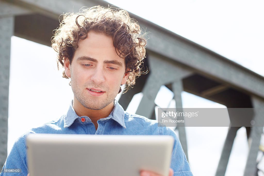 Man in urban area with digital tablet : Stock Photo