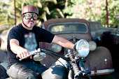 Man in vintage goggles on motorcycle