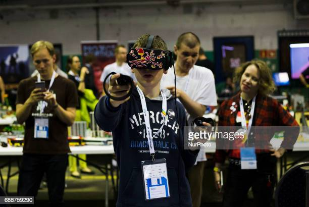 Man in virtual reality glasses on Pixel Heaven fair in Warsaw 26 May Poland