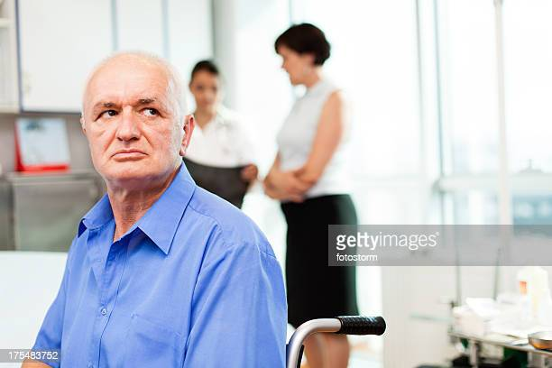 Man in wheelchair at doctor's office