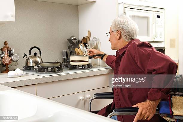 Man in wheelchair cooking