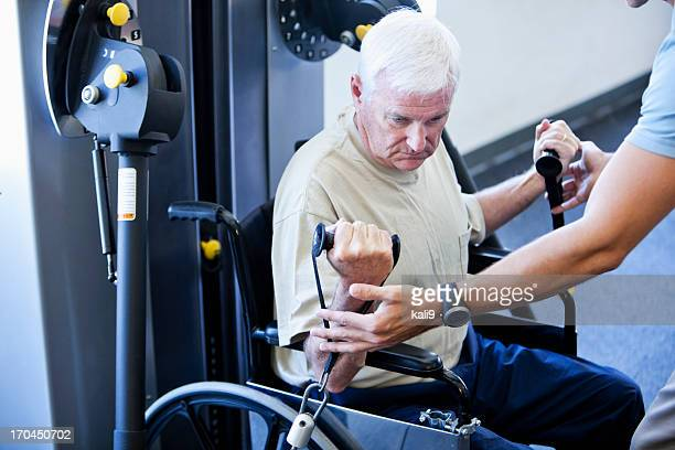 Man in wheelchair doing physical therapy exercises