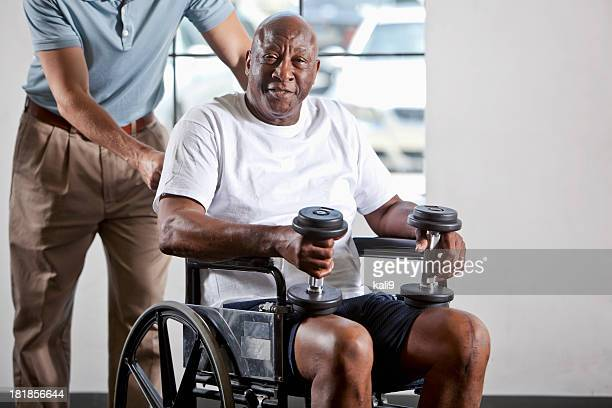 Man in wheelchair doing physical therapy