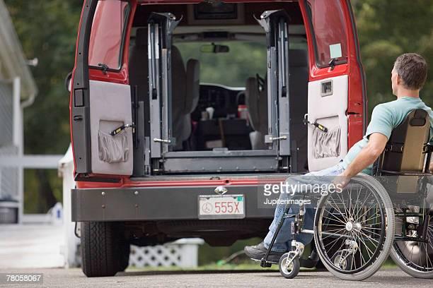 Man in wheelchair entering van