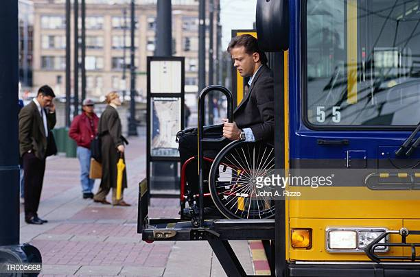Man in Wheelchair Exiting Bus