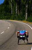 Man in wheelchair race on country road