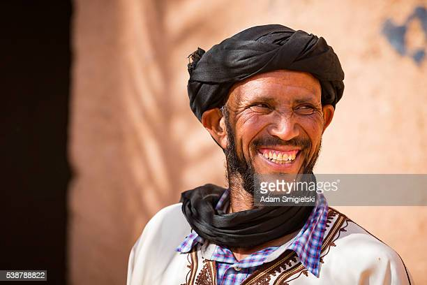 man in white dress posing in kasbah