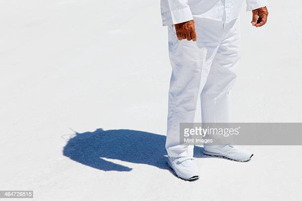 A man in white overalls,a race official timekeeper at a car racing event, at Speed Week on Bonneville Salt Flats.