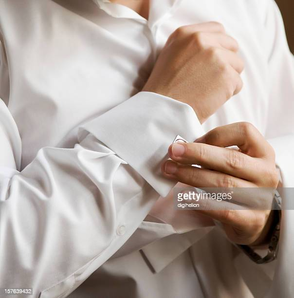 Man in white shirt wearing cufflinks