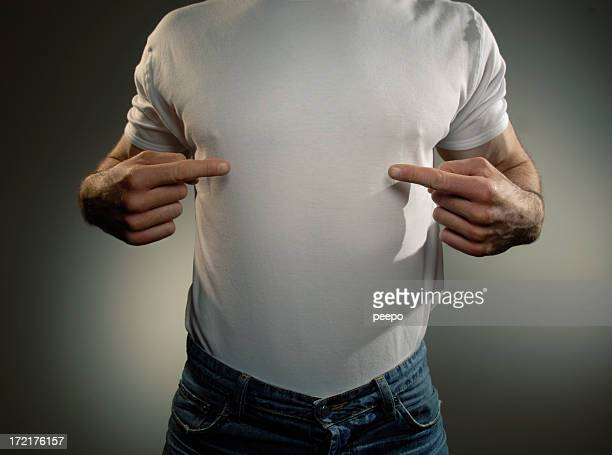 Man in white t-shirt pointing at himself