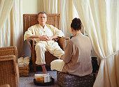 Man in wicker chair in beauty parlour