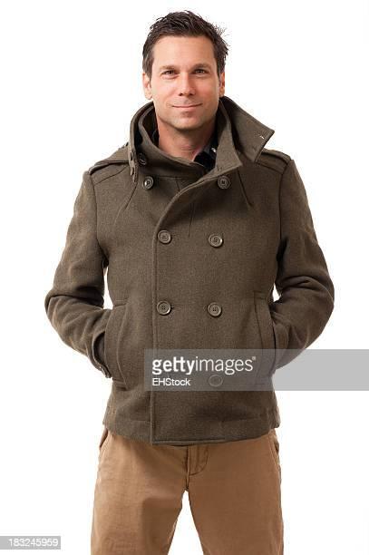 Mann in Winter Coat, isoliert auf weißem Hintergrund