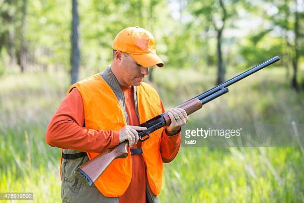 Man in woods hunting with shotgun
