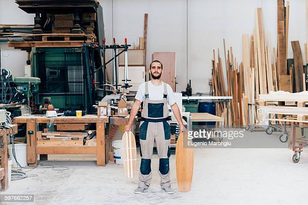 Man in workshop with skateboards