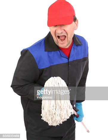 Man in workwear with mop. : Stock Photo