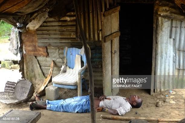 A man infected with the Ebola virus lies unconscious in his house on September 4 2014 at the small city of Banjor 30 kilometers of Monrovia he Ebola...