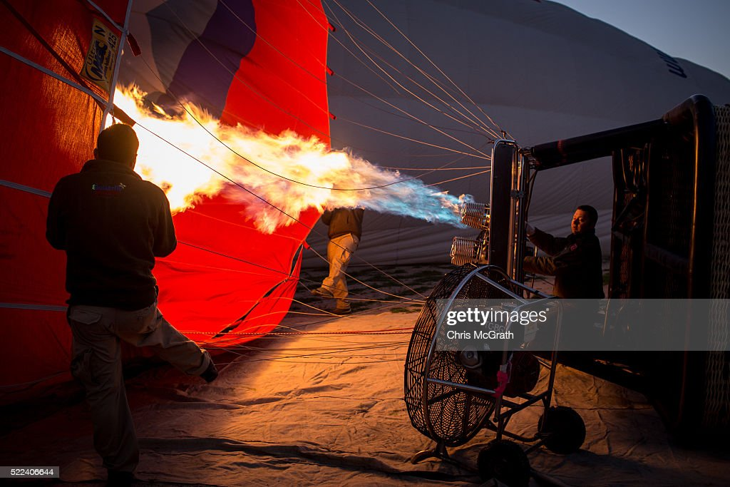 A man inflates a hot air balloon ahead of a tourist flight on April 17, 2016 in Nevsehir, Turkey. Cappadocia, a historical region in Central Anatolia dating back to 3000 B.C is one of the most famous tourist sites in Turkey. Listed as a World Heritage Site in 1985, and known for its unique volcanic landscape, fairy chimneys, large network of underground dwellings and some of the best hot air ballooning in the world, Cappadocia is preparing for peak tourist season to begin in the first week of May. Despite Turkey's tourism downturn, due to the recent terrorist attacks, internal instability and tension with Russia, local vendors expect tourist numbers to be stable mainly due to the unique activities on offer and unlike other tourist areas in Turkey such as Antalya, which is popular with Russian tourists, Cappadocia caters to the huge Asian tourist market.
